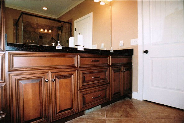 Dark wood vanity in bathroom
